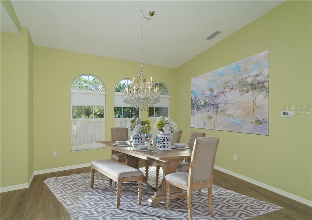 Dining Room virtually staged - Single Family Home for sale at 1714 79th Ct W, Bradenton, FL 34209 - MLS Number is A4416601