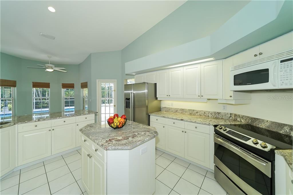 Light & Bright kitchen with door to lanai - Single Family Home for sale at 1714 79th Ct W, Bradenton, FL 34209 - MLS Number is A4416601