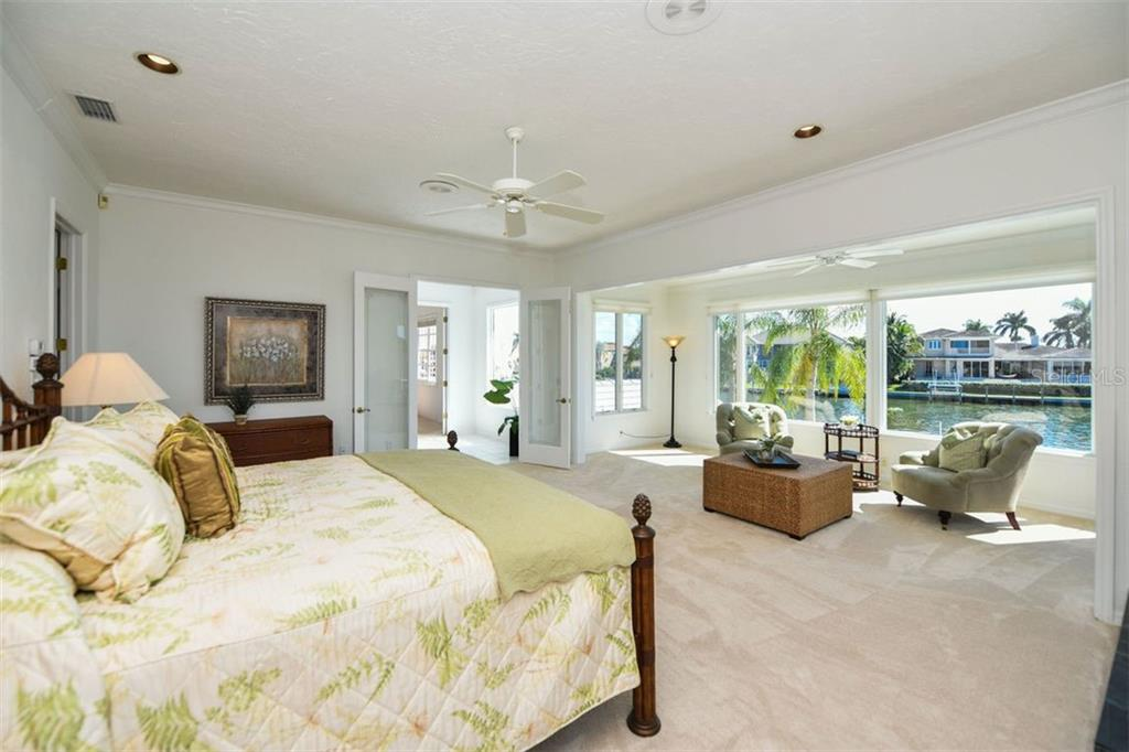 Spacious master, sitting area, wood burning fireplace. - Single Family Home for sale at 7689 Cove Ter, Sarasota, FL 34231 - MLS Number is A4417242