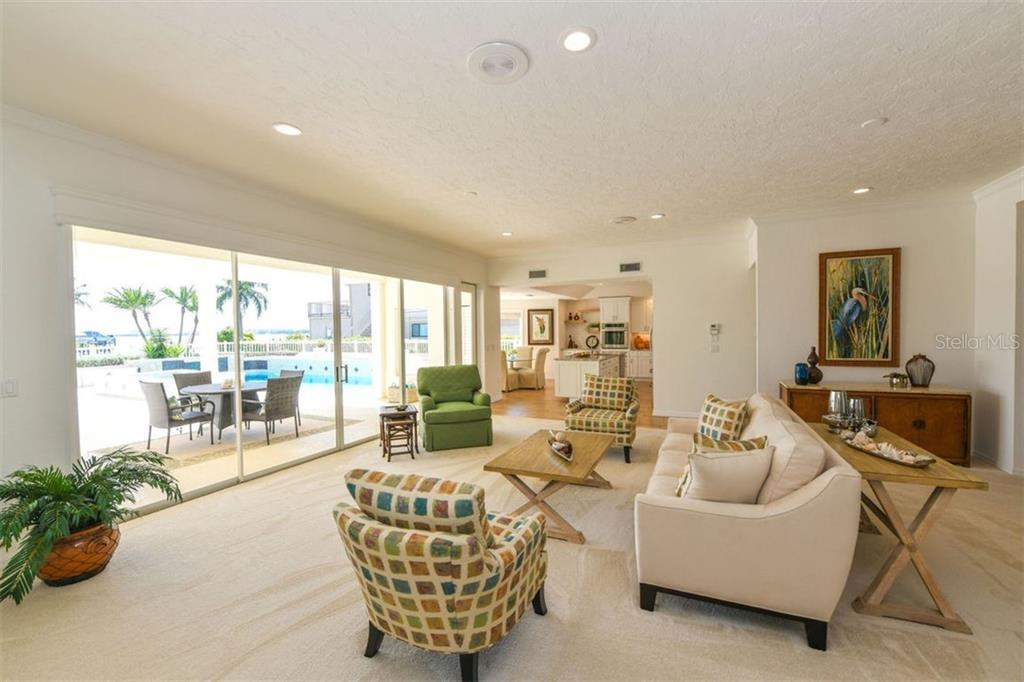 Spacious living room, open to kitchen and formal dining. - Single Family Home for sale at 7689 Cove Ter, Sarasota, FL 34231 - MLS Number is A4417242