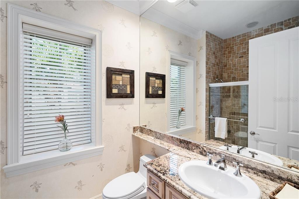 GUEST BATHROOM 2 - Single Family Home for sale at 4121 Founders Club Dr, Sarasota, FL 34240 - MLS Number is A4417319