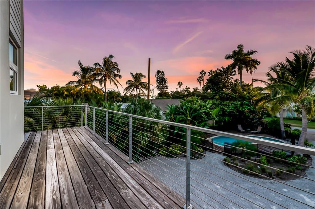 Views from the front deck at twilight - Single Family Home for sale at 7130 Longboat Dr E, Longboat Key, FL 34228 - MLS Number is A4418105