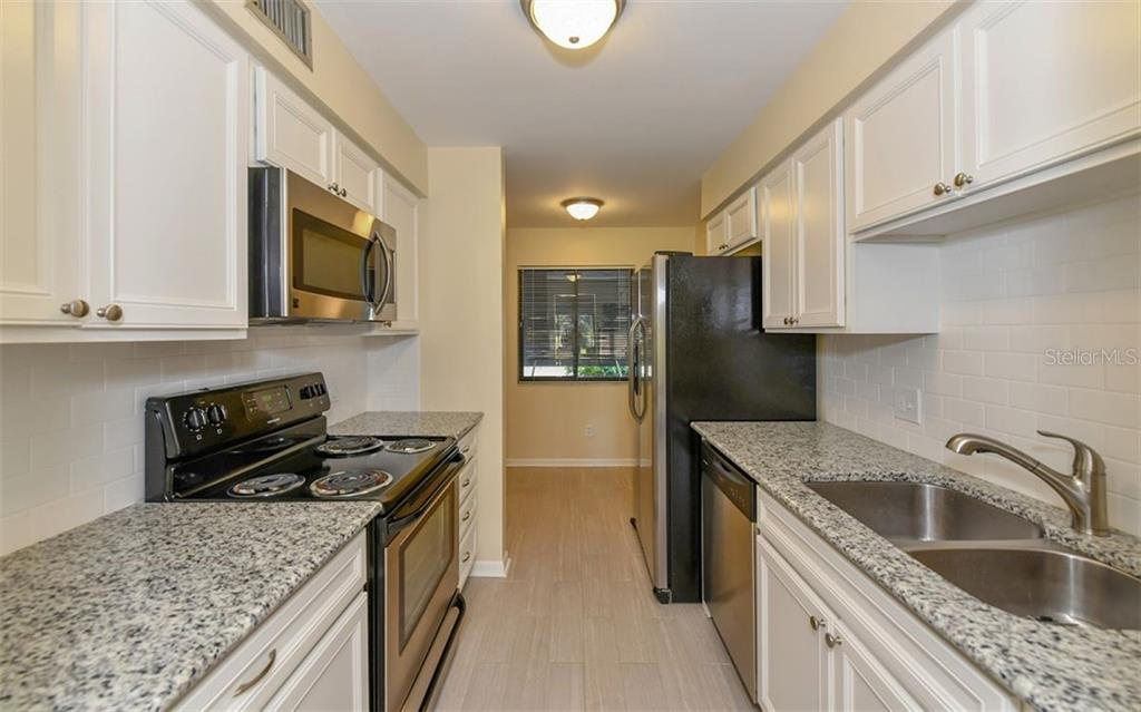 Flexible space at far end of kitchen - small table or desk would fit perfectly! - Condo for sale at 4576 Longwater Chase #59, Sarasota, FL 34235 - MLS Number is A4418168