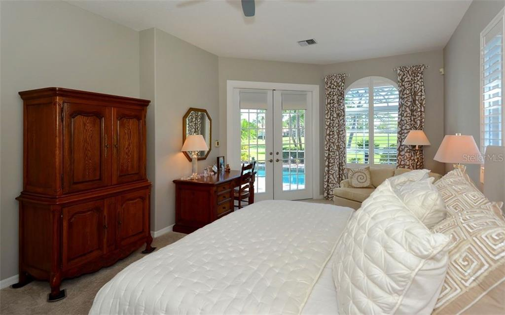Master bedroom with French doors to pool - Single Family Home for sale at 462 Sherbrooke Ct, Venice, FL 34293 - MLS Number is A4418225