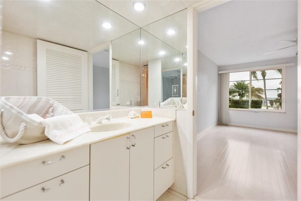 Master bath to bedroom. - Condo for sale at 450 Gulf Of Mexico Dr #b107, Longboat Key, FL 34228 - MLS Number is A4418457