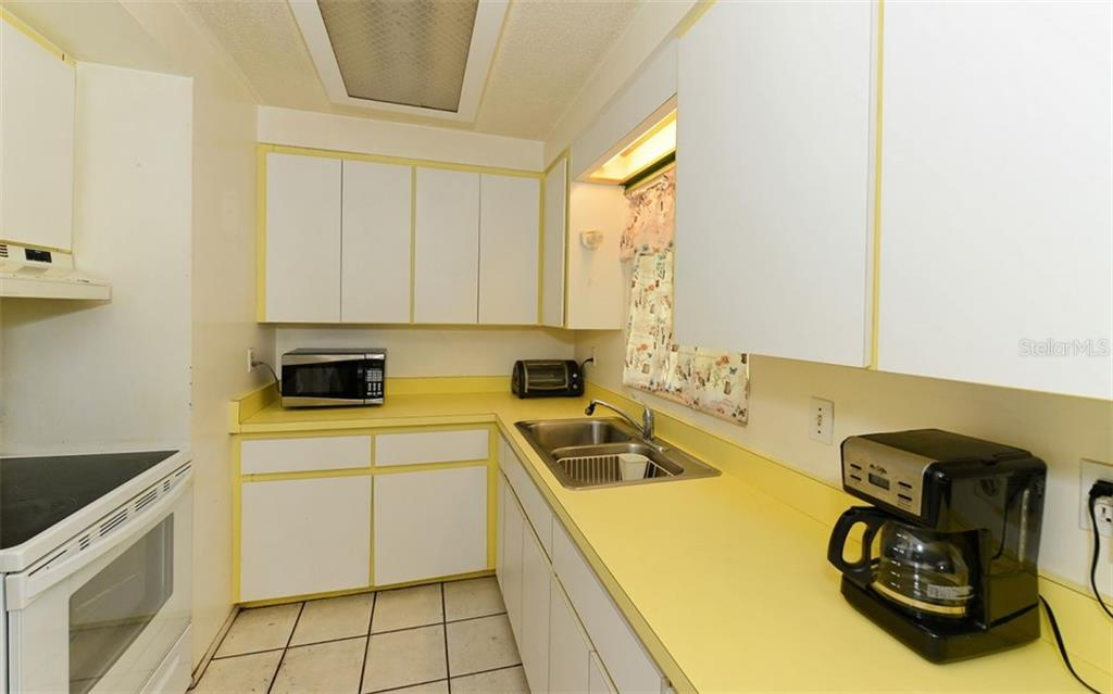 Kitchen - Single Family Home for sale at 2408 Arlington St, Sarasota, FL 34239 - MLS Number is A4418939