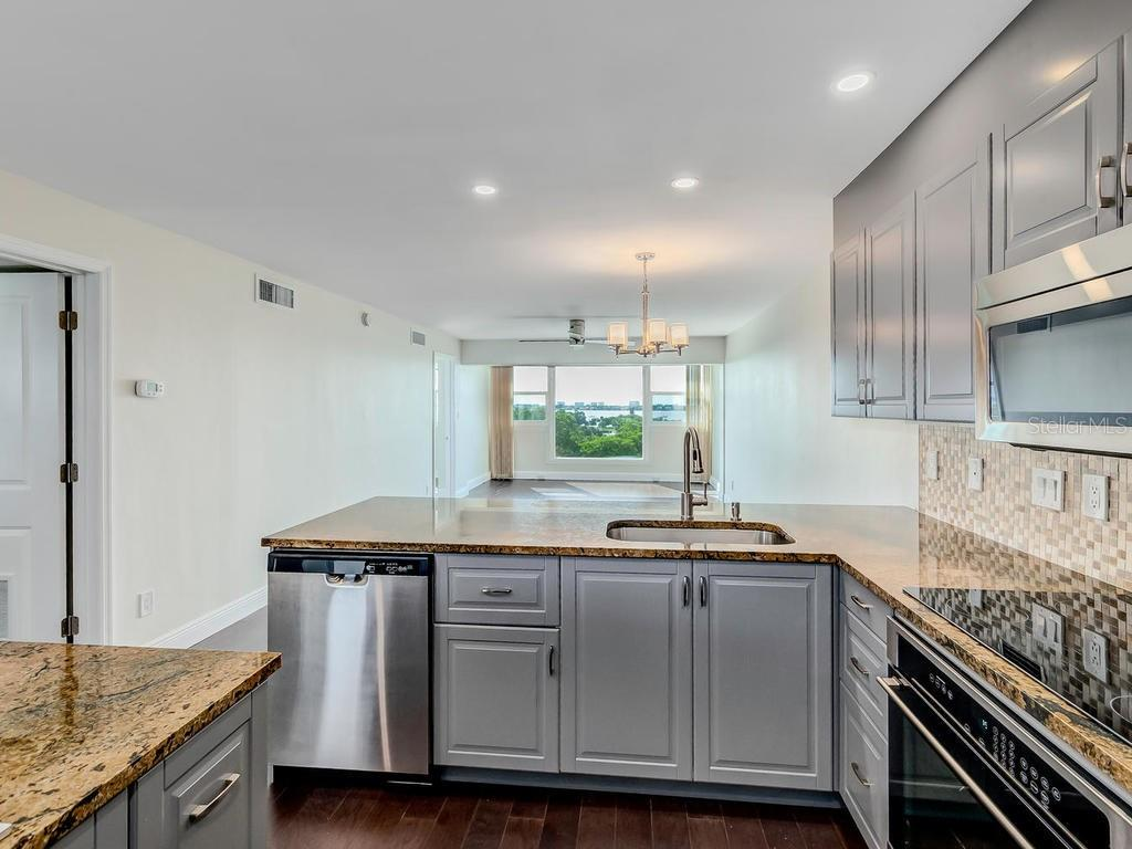 Kitchen water views through open Living Room. - Condo for sale at 33 S Gulfstream Ave #706, Sarasota, FL 34236 - MLS Number is A4419314