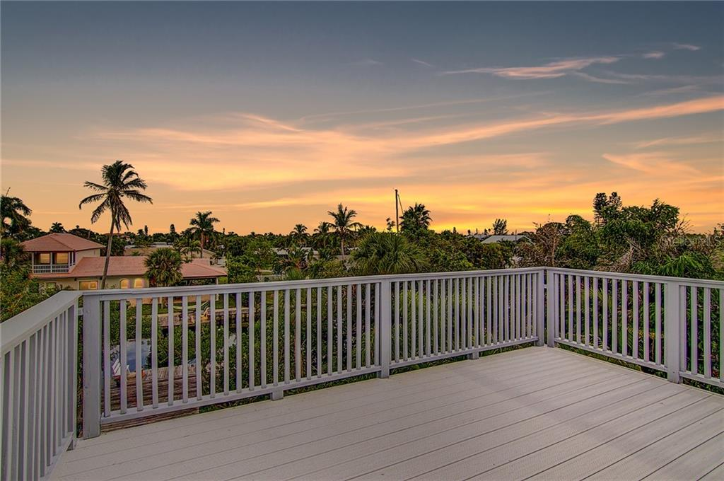Nature's nightly show from the roof - Single Family Home for sale at 521 75th St, Holmes Beach, FL 34217 - MLS Number is A4420243