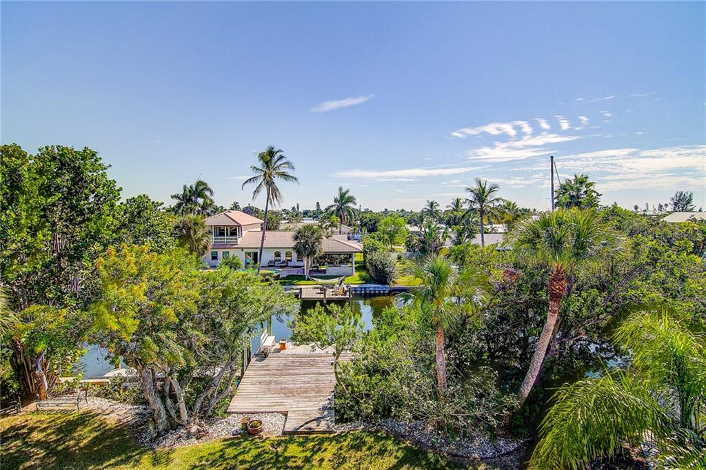 The multi-purpose dock offers something for everyone! - Single Family Home for sale at 521 75th St, Holmes Beach, FL 34217 - MLS Number is A4420243