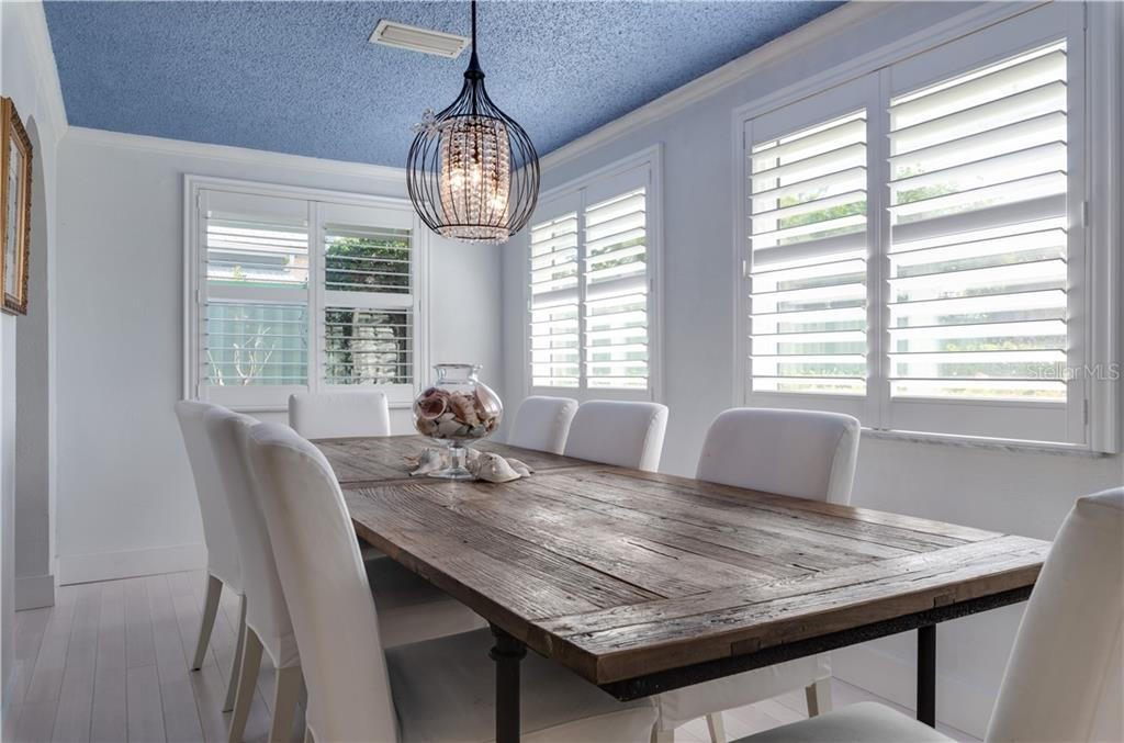 Main House dining room with custom shutters. - Single Family Home for sale at 147 Garfield Dr, Sarasota, FL 34236 - MLS Number is A4420375
