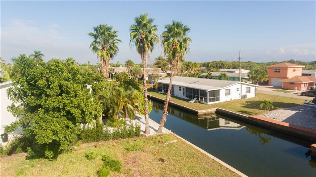 The 2nd floor level, which would be above your garage offers a glimpse of the bay - Vacant Land for sale at 700 Tarawitt Dr, Longboat Key, FL 34228 - MLS Number is A4420879