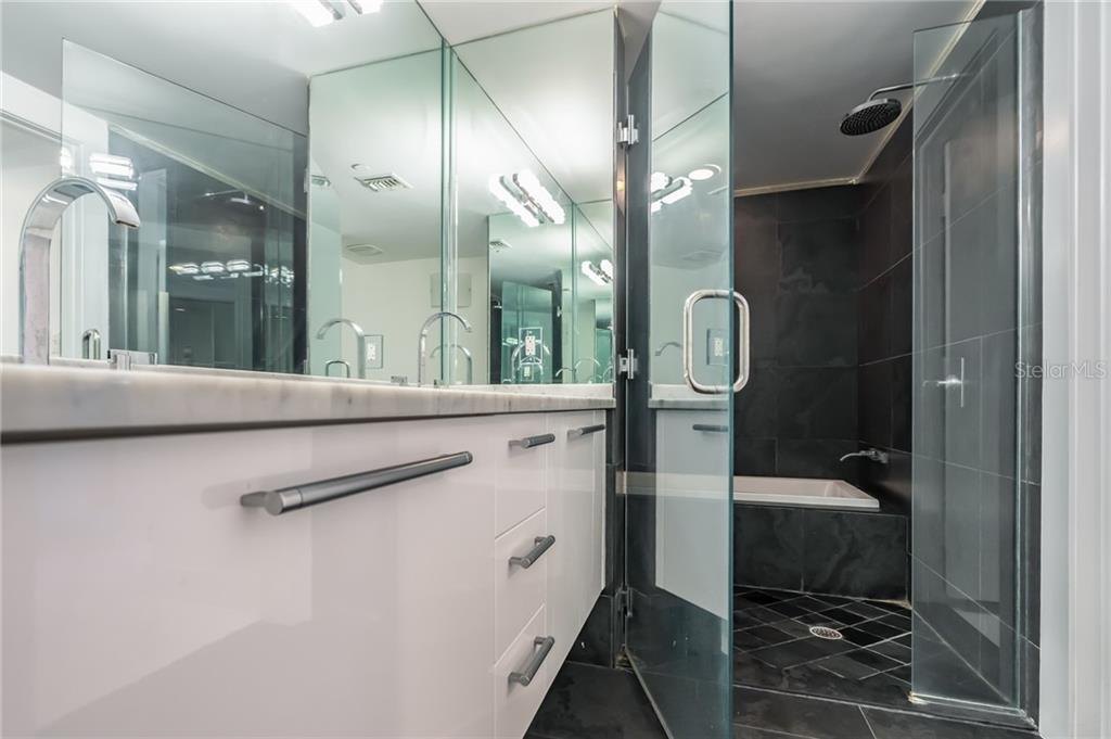 Sleek Bathroom with Shower and Tub - Condo for sale at 900 Biscayne #301, Miami, FL 33132 - MLS Number is A4420957