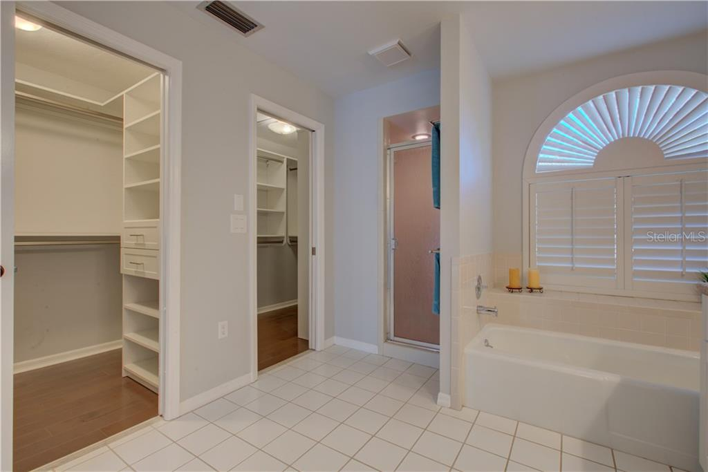 His and Hers walk in closets with custom shelving - Single Family Home for sale at 5167 Kestral Park Ln, Sarasota, FL 34231 - MLS Number is A4421162