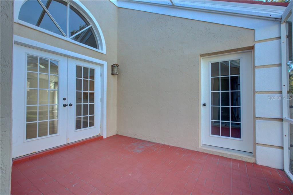 Separate screened in porch area from the dining room and accessible through two bedrooms - Single Family Home for sale at 5167 Kestral Park Ln, Sarasota, FL 34231 - MLS Number is A4421162