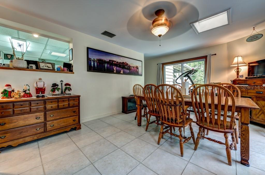 The Florida room is large enough to house a second full dining room and has sliding doors to the side yard. - Single Family Home for sale at 1509 Flower Dr, Sarasota, FL 34239 - MLS Number is A4421898