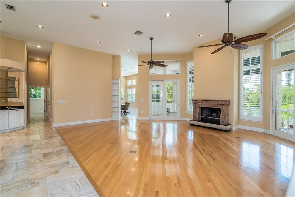 Waterfront great room with high ceilings, french doors and fireplace - Single Family Home for sale at 3640 Flamingo Ave, Sarasota, FL 34242 - MLS Number is A4422130