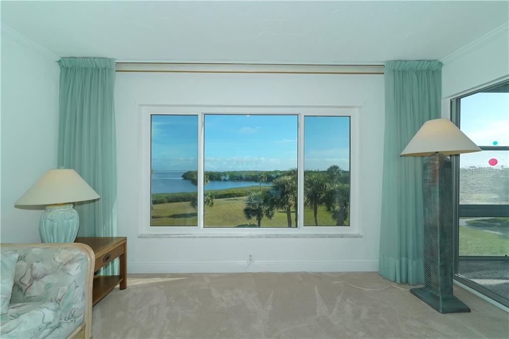 The 23' lanai has a full wall of windows, new carpet and a 10' storage closet. - Condo for sale at 4700 Gulf Of Mexico Dr #305, Longboat Key, FL 34228 - MLS Number is A4422164