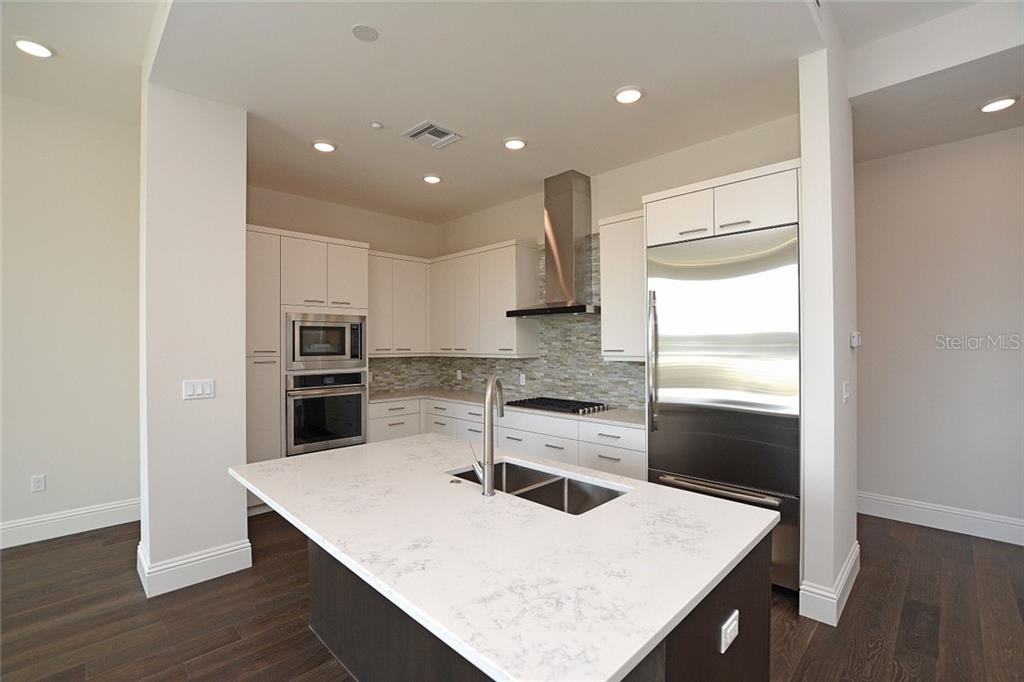 Stunning kitchen with Euro-Tech cabinetry, quartz countertops and Jenn Air appliances. - Condo for sale at 609 Golden Gate Pt #301, Sarasota, FL 34236 - MLS Number is A4422419