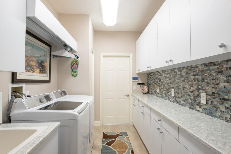 Newly Remodeled Laundry Room - Single Family Home for sale at 7791 Alister Mackenzie Dr, Sarasota, FL 34240 - MLS Number is A4422525