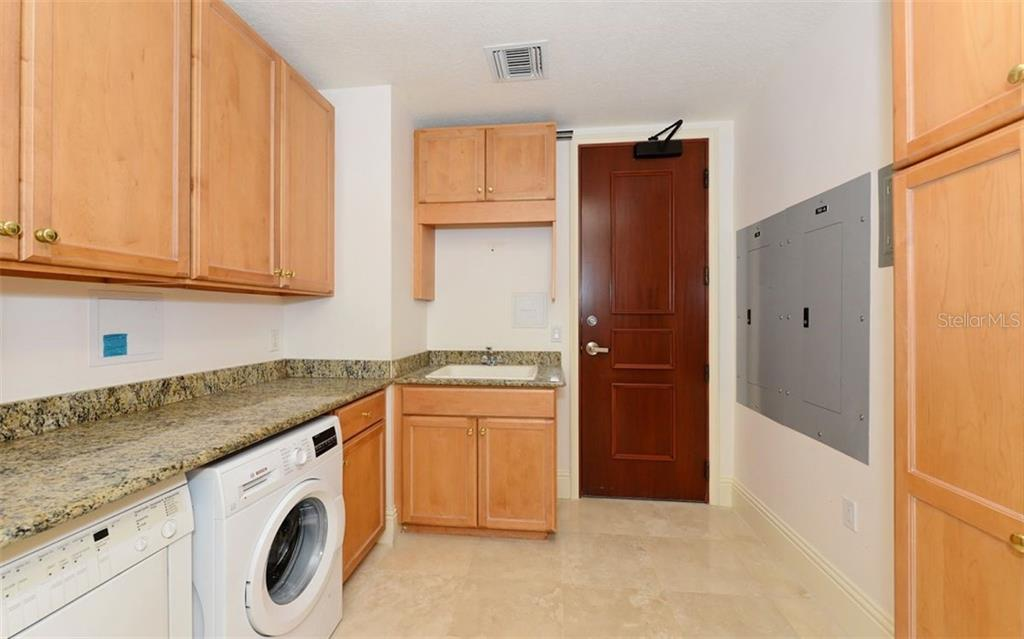 Laundry Room. - Condo for sale at 464 Golden Gate Pt #701, Sarasota, FL 34236 - MLS Number is A4422622