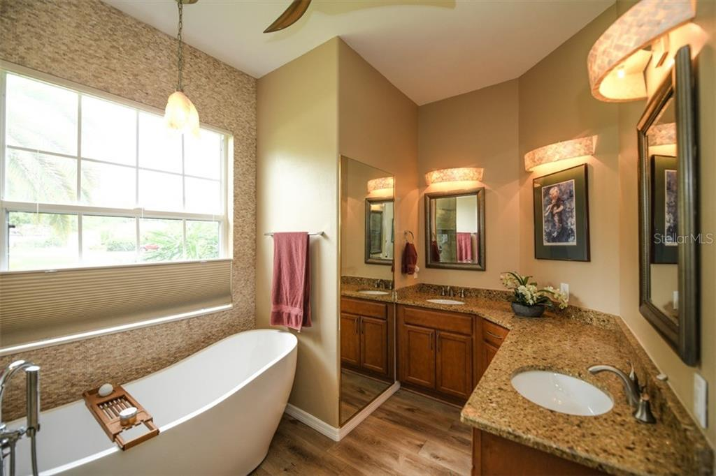Master Bath dual sinks and soaking tub - Single Family Home for sale at 6161 Varedo Ct, Sarasota, FL 34243 - MLS Number is A4422883