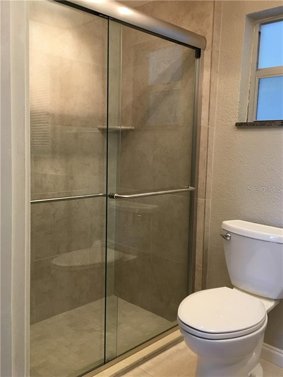 New shower door in master bath. - Villa for sale at 3434 Medford Ln #1110, Sarasota, FL 34239 - MLS Number is A4422897