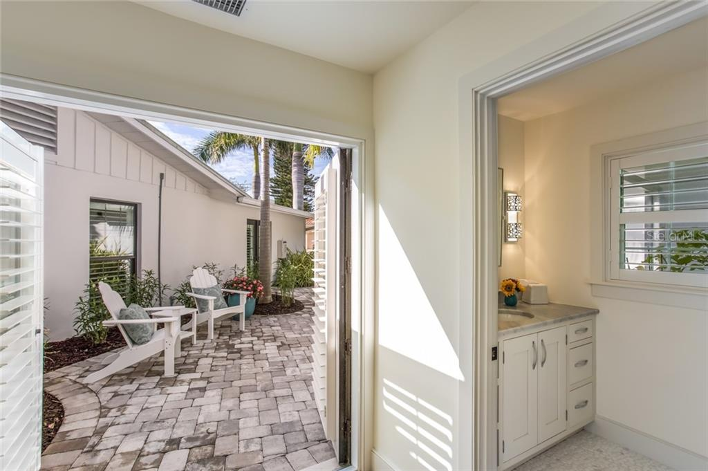 3rd Bedroom wing has 2 Bedrooms and Bath, French doors to garden patio - Single Family Home for sale at 6957 Belgrave Dr, Sarasota, FL 34242 - MLS Number is A4423362
