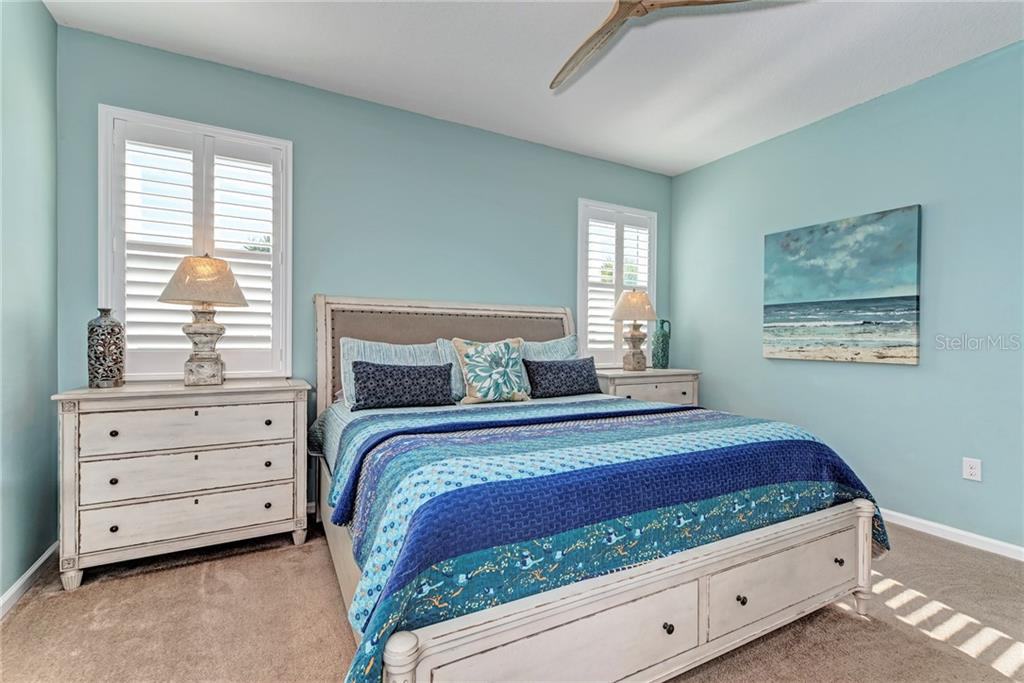 The Master Bedroom features a custom fan, plantation shutters, and a spacious walk-in closet! - Single Family Home for sale at 5260 Bentgrass Way, Bradenton, FL 34211 - MLS Number is A4424484
