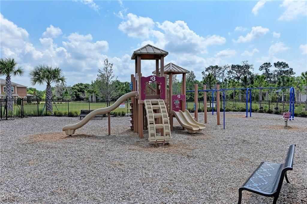 A fenced-in playground is just a short walk away! - Single Family Home for sale at 5260 Bentgrass Way, Bradenton, FL 34211 - MLS Number is A4424484