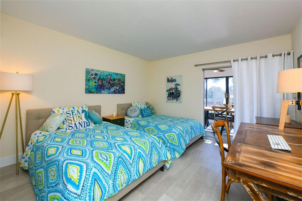 Spacious second bedroom is large enough to hold a King bed as well.  Drapes, rod, and blackout curtains are included. - Condo for sale at 225 Hourglass Way #208, Sarasota, FL 34242 - MLS Number is A4425323