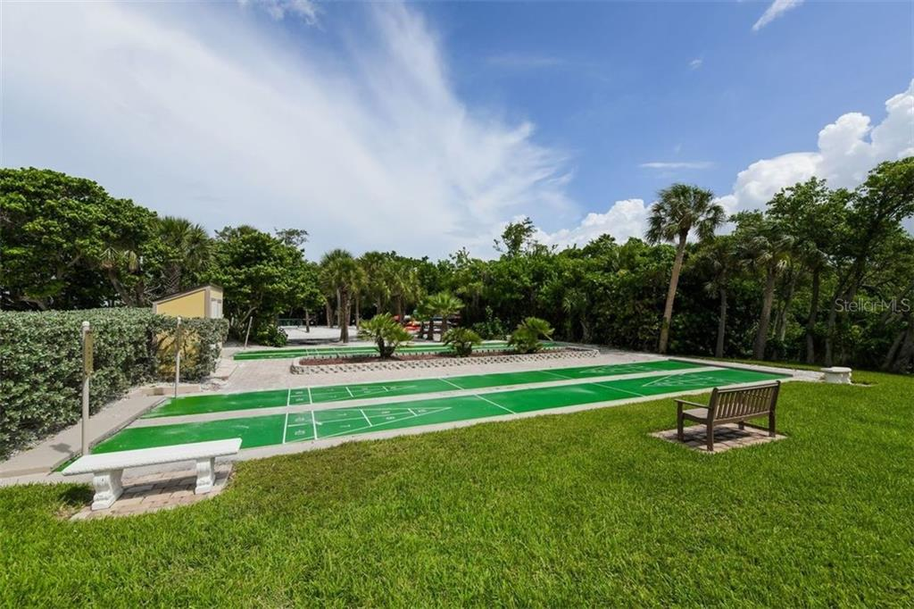 Improve your shuffleboard game with your own beachside courts! - Condo for sale at 225 Hourglass Way #208, Sarasota, FL 34242 - MLS Number is A4425323