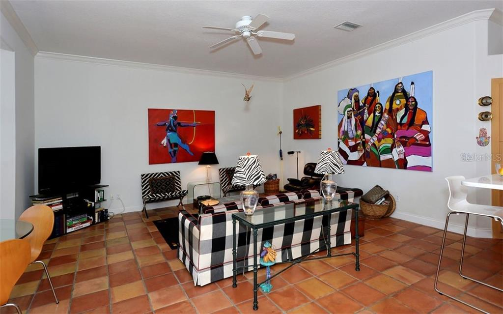 Spacious family room. - Single Family Home for sale at 8926 Grey Oaks Ave, Sarasota, FL 34238 - MLS Number is A4425574