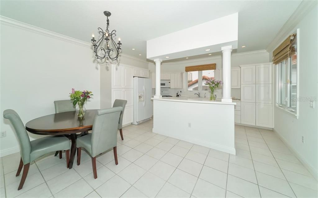 The dining area and kitchen. - Condo for sale at 1283 Fruitville Rd #a, Sarasota, FL 34236 - MLS Number is A4426039