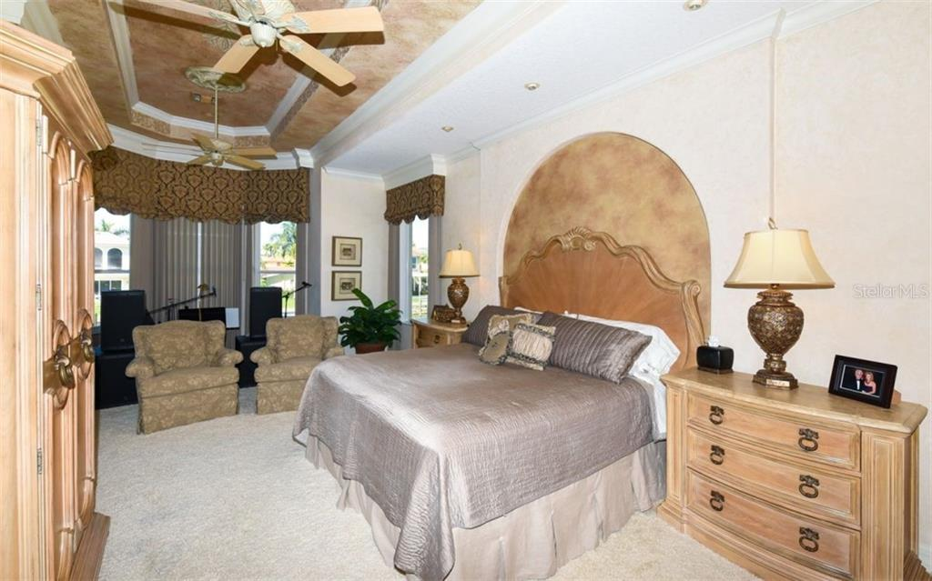 Spacious Master Bedroom with Double Trey Fo Painted Ceiling and alcove behind King Bed. - Single Family Home for sale at 561 Ketch Ln, Longboat Key, FL 34228 - MLS Number is A4426280
