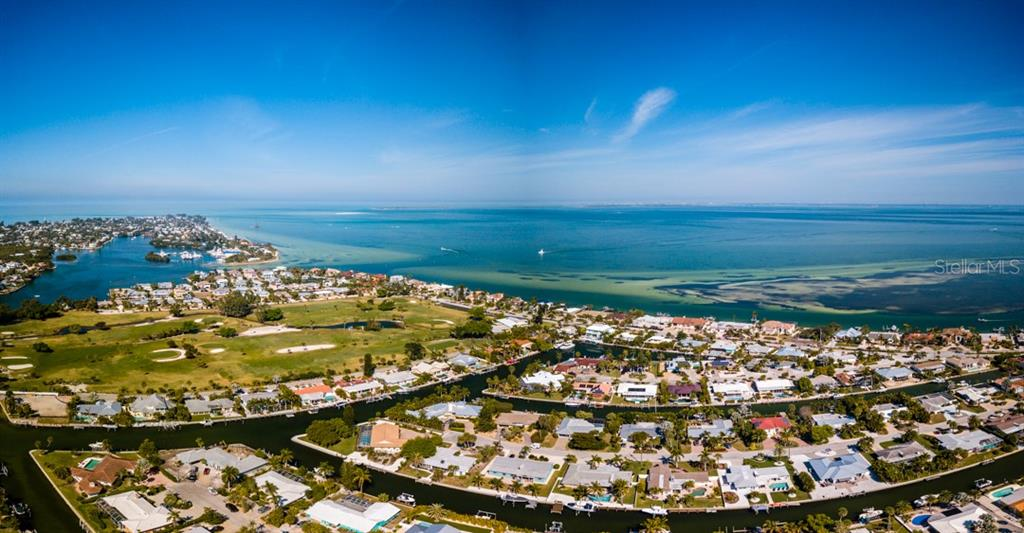 Aerial view of the Bay - Single Family Home for sale at 622 Dundee Ln, Holmes Beach, FL 34217 - MLS Number is A4426329