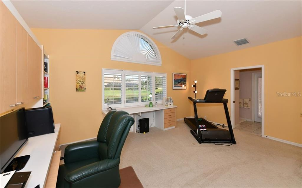 Bedroom 4 has built in desk and full bath that opens to pool area - Single Family Home for sale at 7867 Estancia Way, Sarasota, FL 34238 - MLS Number is A4426528