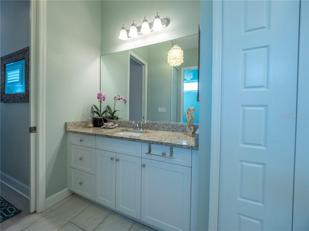 Master bath with dual granite top vanities and two linen closets - Single Family Home for sale at 3611 4th Ave Ne, Bradenton, FL 34208 - MLS Number is A4426978