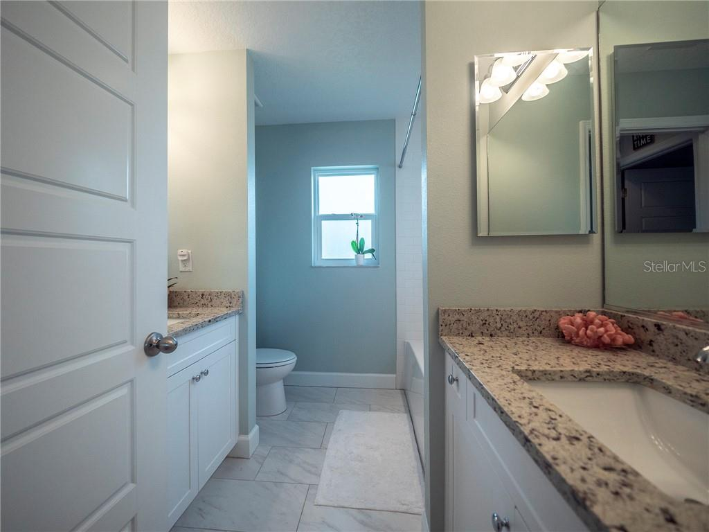 Guest bathroom with dual granite vanities - Single Family Home for sale at 3611 4th Ave Ne, Bradenton, FL 34208 - MLS Number is A4426978