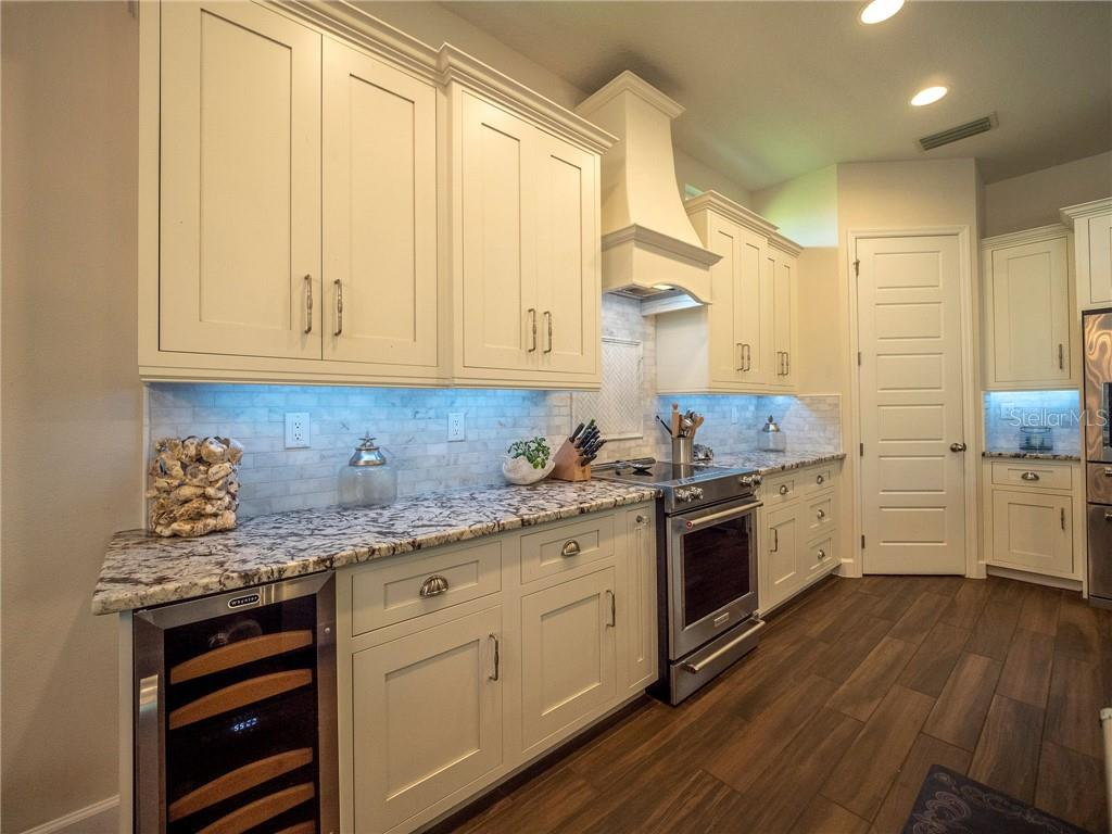 Carrara marble subway backsplash with marble herringbone mosaic and custom stone cast hood - Single Family Home for sale at 3611 4th Ave Ne, Bradenton, FL 34208 - MLS Number is A4426978
