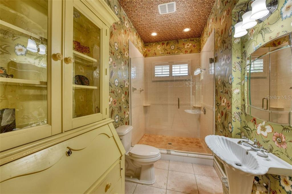 Bathroom 2, walk in shower. - Single Family Home for sale at 737 Eagle Point Dr, Venice, FL 34285 - MLS Number is A4428917