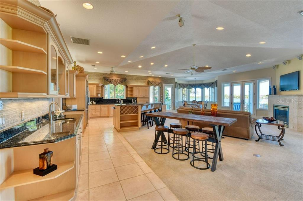 Expansive views in an open great room concept with vaulted ceiling, gas fireplace too. - Single Family Home for sale at 737 Eagle Point Dr, Venice, FL 34285 - MLS Number is A4428917