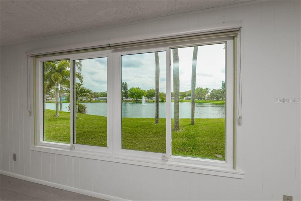 Lake View From Florida Room - Single Family Home for sale at 2424 Terry Ln, Sarasota, FL 34231 - MLS Number is A4429030