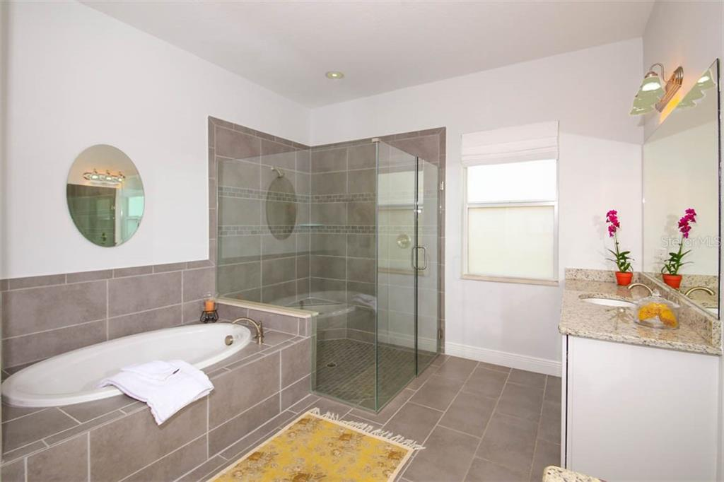 Master bath has luxurious soaking tub and large walk-in shower - Single Family Home for sale at 5504 Tidewater Preserve Blvd, Bradenton, FL 34208 - MLS Number is A4429479