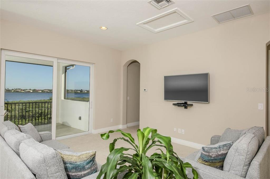 Watching movies or nature is your choice in this space - Single Family Home for sale at 5504 Tidewater Preserve Blvd, Bradenton, FL 34208 - MLS Number is A4429479
