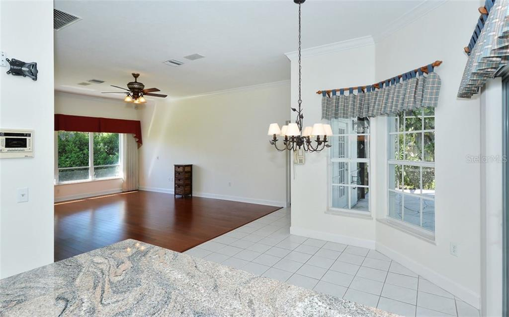 The large family room is just off of the kitchen - Single Family Home for sale at 1636 Liscourt Dr, Venice, FL 34292 - MLS Number is A4429524