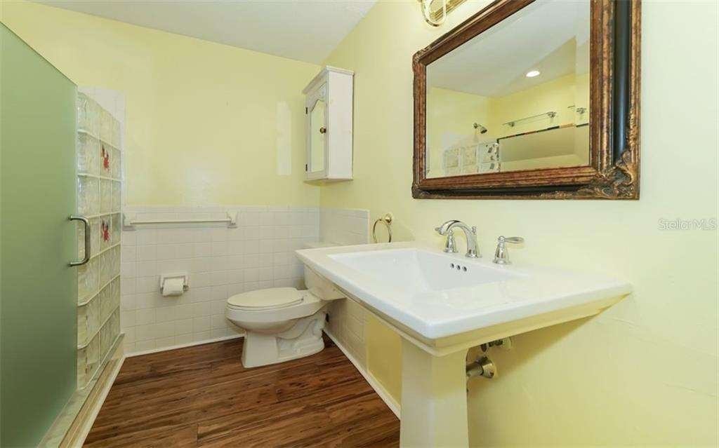 Updated Full Bathroom 2 - Single Family Home for sale at 310 Bayview Pkwy, Nokomis, FL 34275 - MLS Number is A4430065
