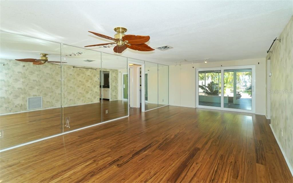 Living/Dining Area - Single Family Home for sale at 310 Bayview Pkwy, Nokomis, FL 34275 - MLS Number is A4430065