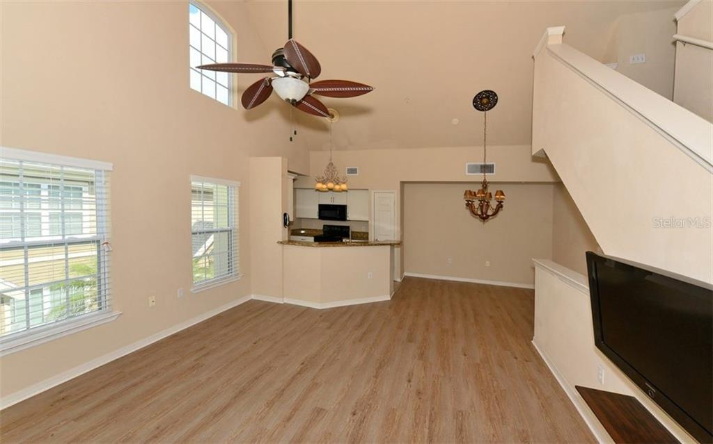 Dining Room virtually staged. - Condo for sale at 5701 Soldier Cir #204, Sarasota, FL 34233 - MLS Number is A4430587