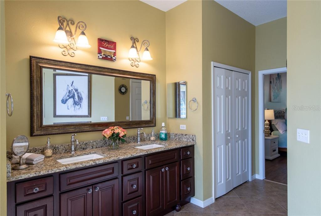 Guest bathroom with tub and shower - Single Family Home for sale at 29215 Saddlebag Trl, Myakka City, FL 34251 - MLS Number is A4431037