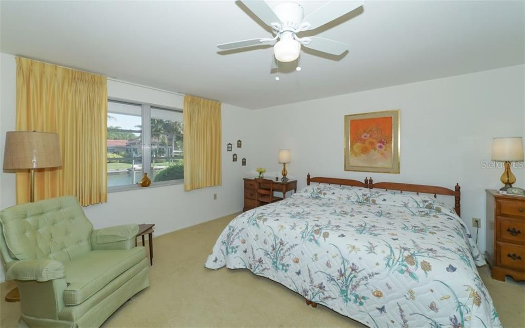 Master Bedroom Overlooking the Canal - Single Family Home for sale at 935 Contento St, Sarasota, FL 34242 - MLS Number is A4431223